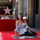 Actor Russell poses on her star after it was unveiled on the Hollywood Walk of Fame in Los Angeles. Photo: Reuters