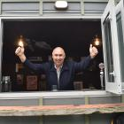 Dave Knox celebrates his ''Man cave'', which he paid $10,500 for at auction at the Great Kiwi...