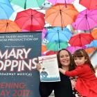 Karen (left) and Addison (5) Cope, of Dunedin, with a list of prizes worth more than $7500 in the...