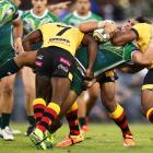 A strong PNG defence hit the Cook Islands hard. Photo: Getty