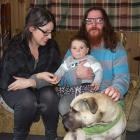 Liz Boyle and Joel Rowlands with their son, Rhythm, and dog Bossco at their rented home at...