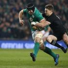 Sean O'Brien tries to get out of the tackle of Beauden Barrett in Ireland's second game against...