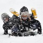 Liam Gillies (left) and Kailen Beattie (both aged 12) have fun in the snow at Wakari Hospital in...