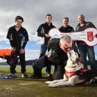 Dermot Mayock gets some love from search and rescue dog Fin as New Zealand Certified Builders...