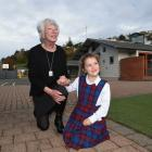 Retiring St Bernadette's School principal Jan Taylor with pupil Elise Frazer (5), her fourth...