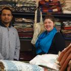 Dunedin Curtain Bank manager Tess Trotter (right) and volunteer Saravana Kumar stand in front of...