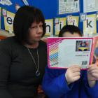 Abbotsford School teacher aide Virginia Walker helps Henry Allison (6) with his reading. PHOTO:...