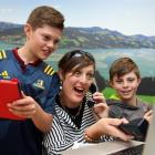Ed Sheeran fan Trista Townsend and sons Jonty (11, left) and Harry (9), of Dunedin, prepare to...