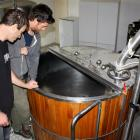 Inspecting the former McDuff's brewery mash tun from Dunedin are  Oli Boyes and Julian Webster,...