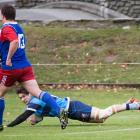 Wakatipu winger Daniel O'Shea dots down in front of Maniototo centre Angus Gibb in  the White...