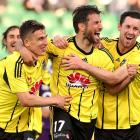 Wellington Phoenix players celebrate a goal.