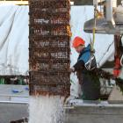 Sanford's boat San Mystic uplifts the first of its oyster cages in Big Glory Bay, Stewart Island,...