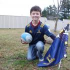 Cromwell boy Ben Griffiths (9) is gearing up to run the ball out at the Highlanders v Lions game...