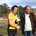 Ben Purvis (left) is presented with an All Black cap to replace his  late father Neil's cap by...