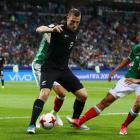 New Zealand's Chris Wood looks to evade Mexico's Jesus Corona during the team's meeting at the...