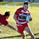 Fullback Tyler Bichan, who is pictured playing for Clutha against Cromwell last year in Balclutha...