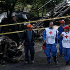 Rescue personnel coordinate to search for missing miners after an explosion at a Colombian underground coal mine. Photo: Reuters