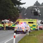 A rescue helicopter lands at the scene of a fatal two-car collision just south of Waikouaiti...
