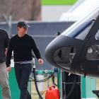 Actor Tom Cruise (right) chats to Andy Clayton at Queenstown Airport yesterday after a helicopter...