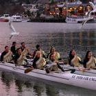 The setting sun tinted the sky red, birds circled and waka are paddled ashore to a formal...
