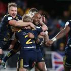 Highlanders players celebrate after winning their game against the Lions. Photo: Getty Images