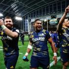 Highlanders players celebrate after their victory over the Lions in Dunedin last night. Photo Getty