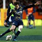 Marty Banks kicks for goal against the Lions. Photo Getty Images