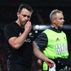 Ben Smith leaves the field after taking a head knock during the first test between the All Blacks...