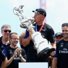 Grant Dalton of Team New Zealand lifts the trophy after New Zealand beat Oracle Team USA to win...