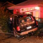 A Ford Explorer has crashed into a house on Great King St in Dunedin. Photo: Stephen Jaquiery