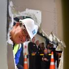 Dunedin Hospital general surgery charge nurse manager Kirk Davidson smashes a hole in a fifth-floor wall at the hospital, to launch the Southern District Health Board's latest interim redevelopment project. Photo: Peter McIntosh