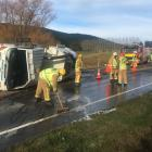 The driver of this truck suffered moderate injuries when it rolled this morning. Photo: Creaig...
