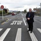 Mosgiel-Taieri Community Board member Martin Dillon at the intersection of Church and Wickliffe...