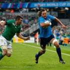 New Otago lock Josh Furno, playing for Italy, tries to beat Irish flanker Peter O'Mahony at the...