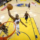 Kevin Durant goes up to slam dunk the ball for the Golden State Warriors in game one of the NBA...