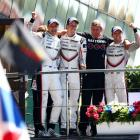 Earl Bamber, Brendon Hartley and Timo Bernhard of the Porsche LMP Team celebrate on the podium...