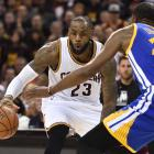 Cavs forward LeBron James takes on Warriors forward Kevin Durant in game three of the NBA Finals....