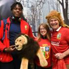 British and Irish Lions lock Maro Itoje poses for a photograph with team mascot BIL and...