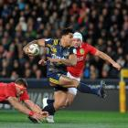 Malakai Fekitoa leaves Lions players (from left) Courtney Lawes, CJ Stander and Rory Best at sixes and sevens at Forsyth Barr Stadium last night. Photo: Gerard O'Brien