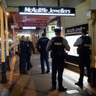 Police attend the scene of an armed robbery at McAuliffe Jewellers in South Dunedin last night. Photo: Linda Robertson