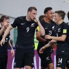 Chris Wood (9) celebrates with All Whites team mates after scoring against Mexico at the...