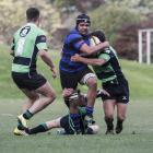 Excelsior flanker Morgan Dawes tries to bust through the Maheno defence in a Citizens Shield game...