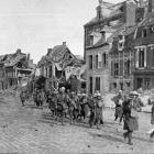 British troops entering the ruins of the town of Peronne, in Northern France, after driving out...
