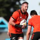 Kieran Read (L) goes into a tackle during a New Zealand All Blacks training session. Photo: Getty