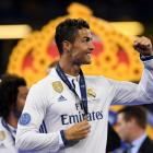 Real Madrid's Cristiano Ronaldo celebrates with his winners medal at the Champions League final....