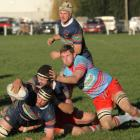 Central Otago lock Willie Miller reaches over to score a try against Southern Region in the Topp...