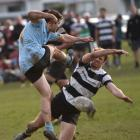 University's Tom Morrison kicks the ball into Southern's Ben Leggett during their Dunedin premier club rugby match at Bathgate Park on Saturday. Photo: Peter McIntosh