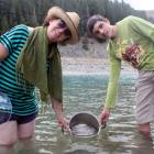 Pip Harker and Nicholas Rumore draw  water from a beach near the Lake Hawea dam in January.  Ms...