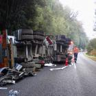 Attempts are made to salvage a crashed fuel tanker off the Haast Pass road  yesterday afternoon....