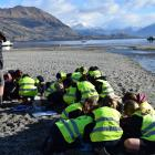 Groups of Wanaka Primary School year 5 and 6 pupils examine a sample of water taken from Bullock...